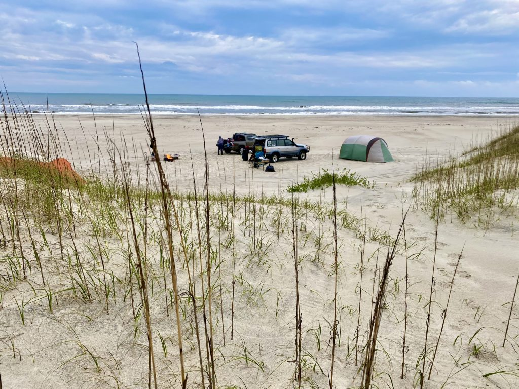 View of a beach campsite from the dunes.