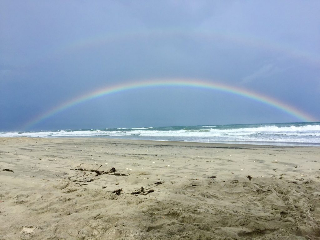 Double rainbow over the beach